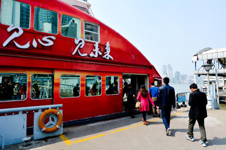 pudong district: SHANGHAI - MAR 16 2015:Passengers get on a ferry boat in Shanghai, China. The ferry connect between the Lujiazui area of the Pudong district to Shanghai The Bund - Waitan.