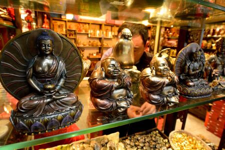 gautama buddha: SHANGHAI - MAR 16 2015:Statues of Gautama Buddha on display.Buddhism practiced by about 500 million people representing 8% of the worlds total population.It practiced by 1,349,585,838 people in China Editorial