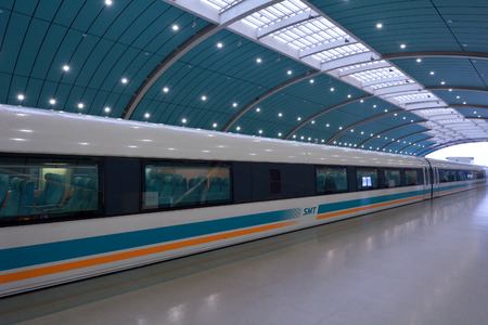 commercially: SHANGHAI, CN - MAR 15 2015:Shanghai Maglev Train -Shanghai Transrapid. The line is the first commercially operated high-speed magnetic levitation line in the world