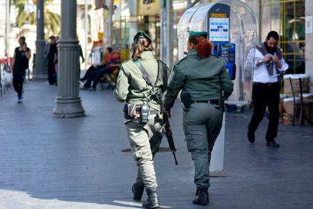 counterterrorism: JERUSALEM, ISR - MAR 15 2015:Israel Border Police women patrolling in Jerusalem, Israel.Israel Border Police is composed of professional officers on payroll and field policemen redirected from the IDF