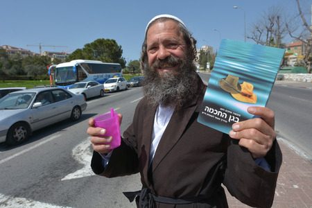 obligation: JERUSALEM, ISR - MAR 24 2015:Orthodox Jewish man collecting Tzedakah (charity).In Judaism, tzedakah refers to the religious obligation to do what is right and just as parts of living a spiritual life. Editorial