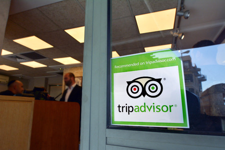 JERUSALEM - MAR 24 2015:Trip advisor sticker on restaurant window in Jerusalem, Israel.TripAdvisor is the most trusted travel website provide over 200M  traveler reviews on destinations and business. Editorial