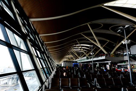 globally: SHANGHAI, CN - MAR 15 2015:Shanghai Pudong International Airport.Shanghai Pudong is the busiest international hub in mainland China, ranking 22nd globally in terms of international traffic Editorial