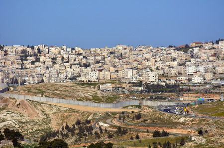 palestinian: JERUSALEM, ISR - MAR 19 2015:The Israeli West Bank barrier in East Jerusalem.It protects Israel civilians from Palestinian political violence such as terror suicide bombing attacks.