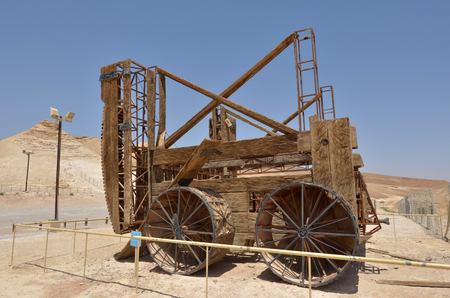MASADA, ISR - APR 29 2015:Reconstruction of a Roman siege engine under Masada stronghold in the Judaean Desert, Israel.Masada is one of Israels most popular tourist attractions Editorial