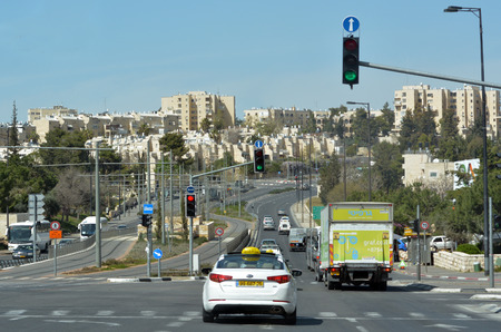 ceasefire: JERUSALEM, ISR - MAR 26 2015:Traffic on Number 01 road in Jerusalem, Israel.It used to be the border and ceasefire line that went through Jerusalem between Israel and Jordan from 1949 till 1967 war. Editorial