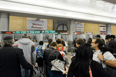 israel passport: TEL AVIV - MAR 20 2015:Passengers enters Israel in Ben Gurion Airport.It considered to be among  the best airports in the Middle East due to its passenger experience and its high level of security.