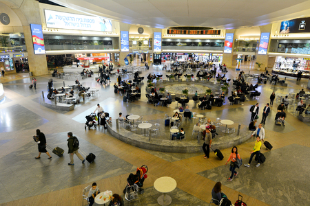 information international: TEL AVIV - MAR 20 2015:Passengers In Terminal 3 of Ben Gurion Airport, Israel.It considered to be among best airports in the Middle East due to its passenger experience and its high level of security. Editorial