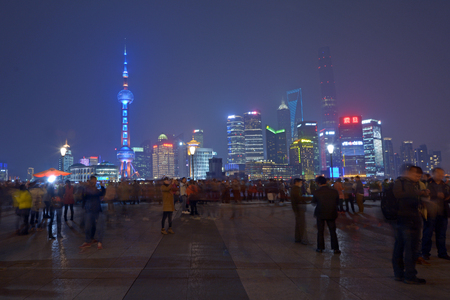 SHANGHAI, CN - MAR 15 2015:Pudong New Area skyline in Shanghai, China at night.Its home to the Lujiazui Finance and Trade Zone, Shanghai Stock Exchange and many of Shanghais best-known buildings.