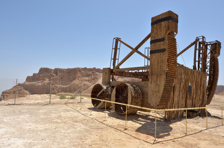 judaean: MASADA, ISR - APR 29 2015:Reconstruction of a Roman siege engine under Masada stronghold in the Judaean Desert, Israel.Masada is one of Israels most popular tourist attractions Editorial