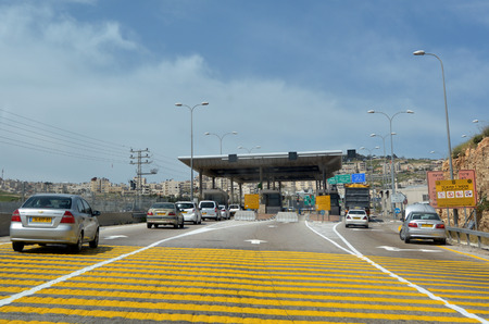 stated: JERUSALEM - MAR 19 2015:Israel Border Police checkpoint to Jerusalem from Maale adumim. The barrier erected by the IDF with the stated aim of enhancing the security of Israel and Israeli settlements. Editorial