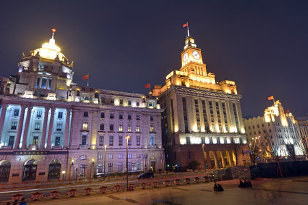 historical buildings: SHANGHAI, CN - MAR 18 2015:Visitors on Shanghai - The Bund or Waitan at night.Shanghai Bund has dozens of historical buildings and It is one of the most famous tourist destinations in Shanghai. Editorial