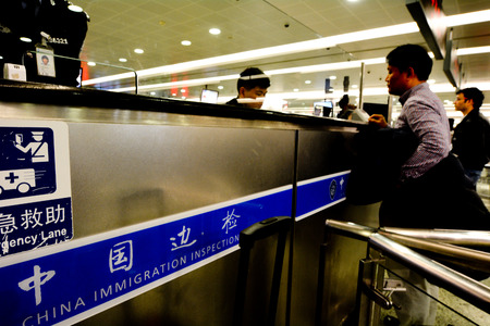 SHANGHAI, CN - MAR 15 2018:China immigration inspection in Shanghai Pudong International Airport.China Immigration Inspection (CII) is the responsible law enforcement authority at major ports in China. Editorial