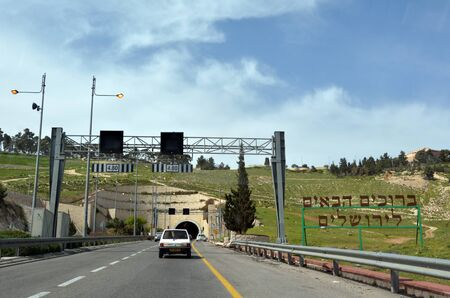 JERUSALEM - MAR 15 2015:Cars enters Mount Scopus Highway Tunnels in Jerusalem, Israel.It's a two parallel two-lane vehicle tunnels about 500 m long linking Maale Adumim Settlement to Jerusalem, Israel. Editorial