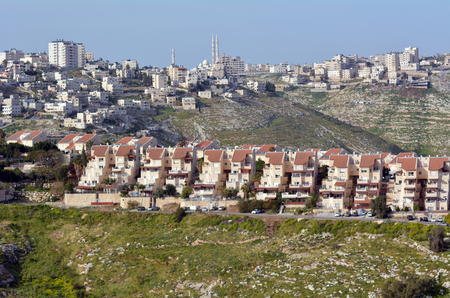 jewish home: MAALE ADUMIM, ISR - MAR 25 2015:Maale Adumim settlement against the arab village al-Eizariya.Its the third largest Israeli settlement in the West Bank and a city of 40,000 residence near Jerusalem.