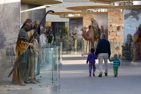 old testament: JERUSALEM - MAR 25 2015:Visitors at Bible city in Jerusalem, Israel.It exhibit is a series of large, colorful and life-size dioramas that depict 62 of the most monumental scenes from the Old Testament