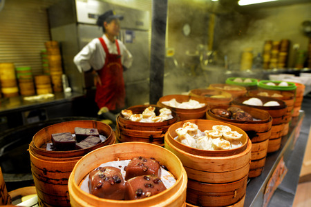 mart: SHANGHAI - MAR 15 2015:Chinese food on display in a food market in Shanghai China.Chinese cuisine go back for thousands of years, changed according to climate, imperial fashions and local preferences.