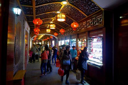 retailing: SHANGHAI, CN - MAR 16 2015:Yuyuan Tourist Mart in Shanghai, China.Shanghai Yuyuan Tourist Mart Company Limited, or Yuyuan Tourist Mart, is the largest retailing conglomerate in China.