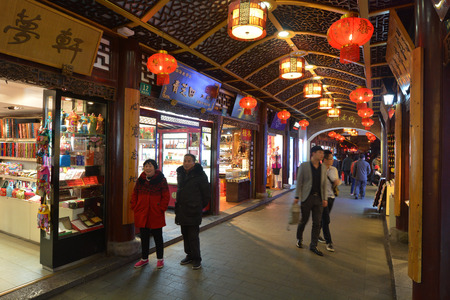 mart: SHANGHAI, CN - MAR 16 2015:Yuyuan Tourist Mart in Shanghai, China.Shanghai Yuyuan Tourist Mart Company Limited, or Yuyuan Tourist Mart, is the largest retailing conglomerate in China.
