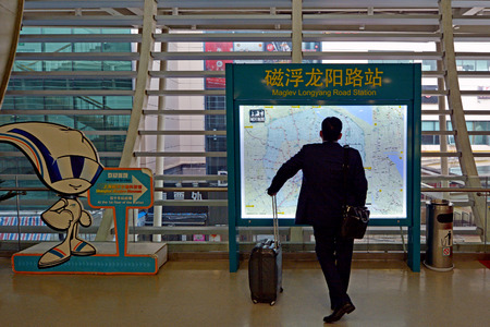 commercially: SHANGHAI, CN - MAR 15 2015:Passenger on the way to Shanghai Maglev Train. The line is the first commercially operated high-speed magnetic levitation line in the world Editorial
