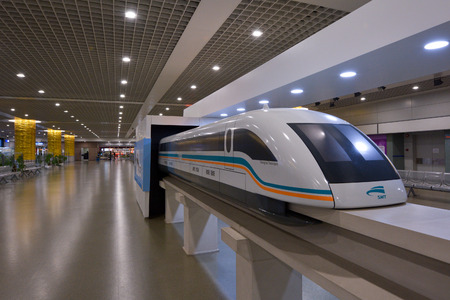 SHANGHAI, CN - MAR 15 2015:Model of Shanghai Maglev Train in the Train Station. The line is the first commercially operated high-speed magnetic levitation line in the world Editoriali