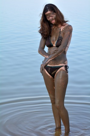 sourced: Young woman enjoying the natural mineral mud sourced from the Dead Sea Israel