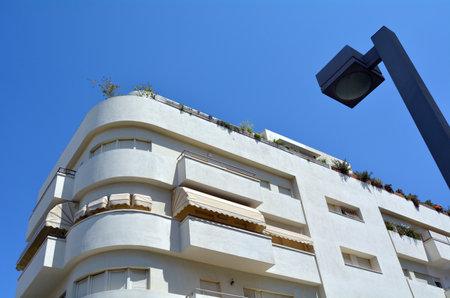 TEL AVIV, ISR - APR 07 2015: White building in Tel Aviv, Israel.Tel Aviv has the largest number of buildings in the BauhausInternational Style of any city in the world. Editorial