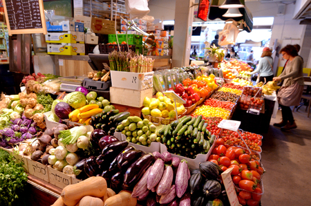 retail scene: TEL AVIV, ISR - MAR 27 2015:Fresh vegetables for sale in Shuk HaNamal Market in Tel Aviv port Israel.Its a food and produce market and the only fully covered of all Tel Aviv's marketplaces.