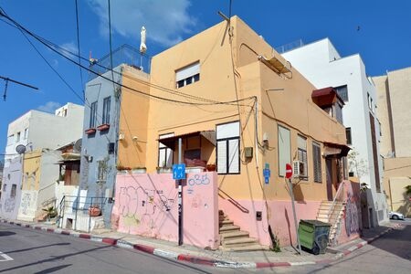 neighbourhood: TEL AVIV - APR 13 2015:Old buildings in Neve Tzedek neighbourhood in Tel Aviv, Israel.It was established in 1887, 22 years before the 1909 founding of Tel Aviv City, by a group of Jewish families Editorial