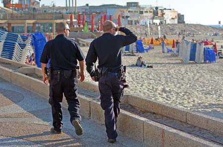 patrolling: TEL AVIV, ISR - APR 07 2015:Two Israel Police officers patrolling on Tel Aviv waterfront.The Israel Police are a professional force, with some 35,000 persons on the payroll.