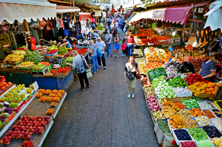 TEL AVIV, ISR - MAR 24 2015:Shoppers at Carmel Market Shuk HaCarmel in Tel Aviv, Israel.Its a very popular marketplace in Tel Aviv sells mostly food and home accessories goods.