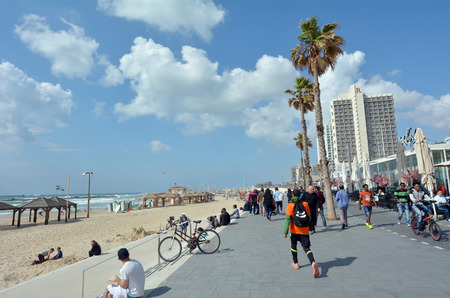 global city: TEL AVIV, ISR - APR 11 2015:Tel Aviv promenade in Tel Aviv Israel. With over a million international visitors annually, Tel Aviv is a global city.
