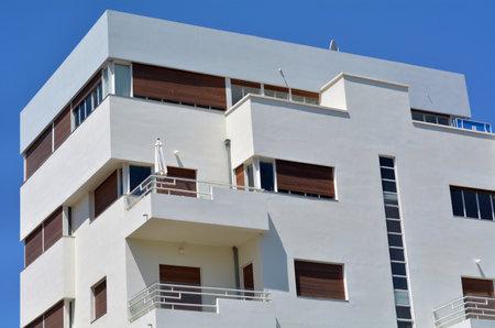 TEL AVIV, ISR - APR 06 2015: White building in Tel Aviv, Israel.Tel Aviv has the largest number of buildings in the BauhausInternational Style of any city in the world.
