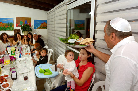 the feast of the passover: JERUSALEM - APR 04 2015:Jewish family celebrate Passover Seder.Its a Jewish ritual feast involving a retelling the story of  liberation of the Israelites from slavery in ancient Egypt 3500 years ago.