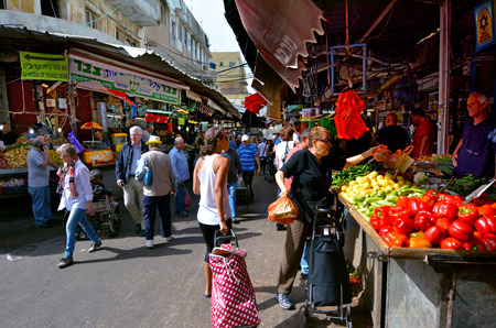 TEL AVIV, ISR - MAR 27 2015:Shoppers at Carmel Market Shuk HaCarmel in Tel Aviv, Israel.Its a very popular marketplace in Tel Aviv sells mostly food and home accessories goods.