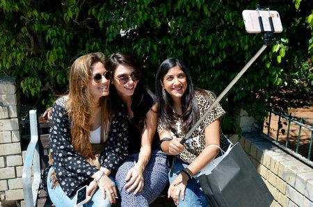 two and two thirds: TEL AVIV, ISR - APR 06 2015:Israeli girlfriend taking selfie.According to a 2013 survey, two-thirds of Australian women age 18%u201335 take selfies.