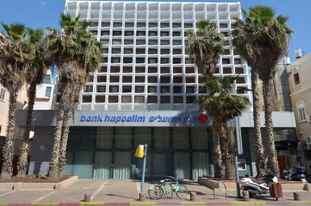 bank owned: TEL AVIV, ISR - MAR 24 2015:Hayarkon Street branch of Bank Hapoalim in Tel Aviv, Israel.Its Israels largest bank with 14,000 employees worldwide. It is owned by Shari Arison.