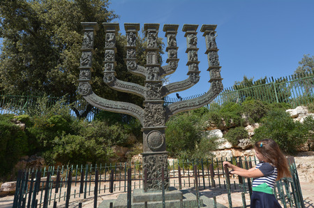 jerusalem: Israeli Jewish girl visit at the Knessets Menorah sculpture in Jerusalem, Israel