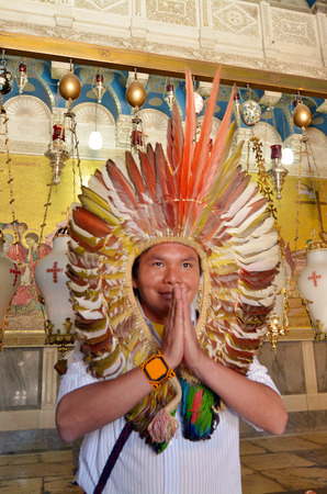holiest: JERUSALEM - MAY 05 2015:Indigenous Indian Pilgrim pray at the Church of the Resurrection in Jerusalem, Israel. The Church considered to be the holiest Christian site in the world.