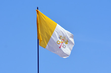 roman catholic: JERUSALEM - MAY 05 2015:Flag of the Holy See in Jerusalem, Israel. Since 1994 the Vatican reiterating demands for control of religious sites in Jerusalem, Israel. Editorial