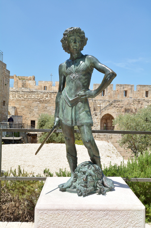 JERUSALEM - MAY 05 2015:David and Goliath sculpture at the Tower of David and archeological garden in Jerusalem, Israel.Its a famous landmark of Jerusalem with historical significant.