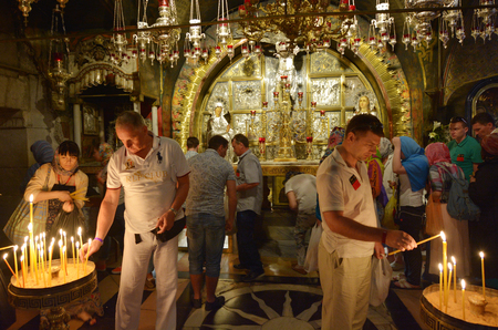 holiest: JERUSALEM, ISR - MAY 05 2015:Pilgrims at Golgotha  Altar of the Crucifixion at the Church of the Resurrection in Jerusalem, Israel. The Church considered to be the holiest Christian site in the world.