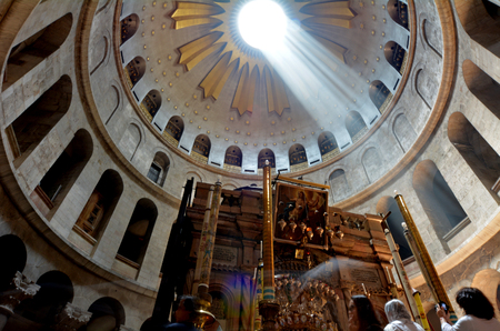 rotunda: JERUSALEM, ISR - MAY 05 2015:Pilgrims at the Stone Rotunda and Aedicule at the Church of the Resurrection in Jerusalem, Israel. The Church considered to be the holiest Christian site in the world.