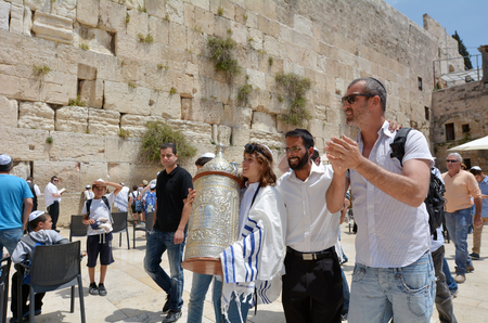 JERUSALEM, ISR - MAY 05 2015:Bar Mitzvah ritual at the Wailing wall in Jerusalem, Israel.Boy who has become a Bar Mitzvah is morally and ethically responsible for his decisions and actions. Editorial