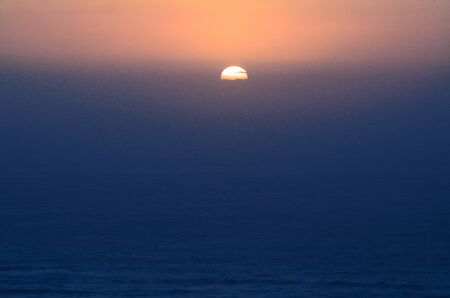 Sunset in Cape Reinga at the edge of the northland of New Zealand. photo