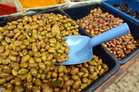 middle easter: Olives on display in Middle eastern food market in Akko Acre Israel. Food texture. Stock Photo