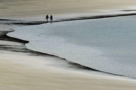 hands fire passion: Couple walks in a secloded beach.