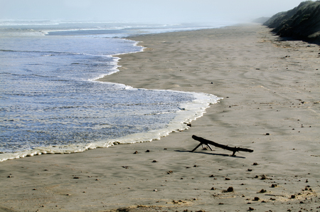 rote: A high tide sea wave hits Ninety Mile beach in Northland New Zealand. Stock Photo