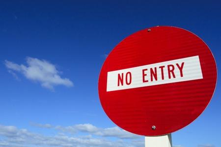 do not enter: Do not enter - roadsign under cloudy blue sky.