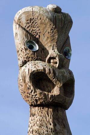aotearoa: A curved Maori  statue in Auckland, New Zealand. Stock Photo
